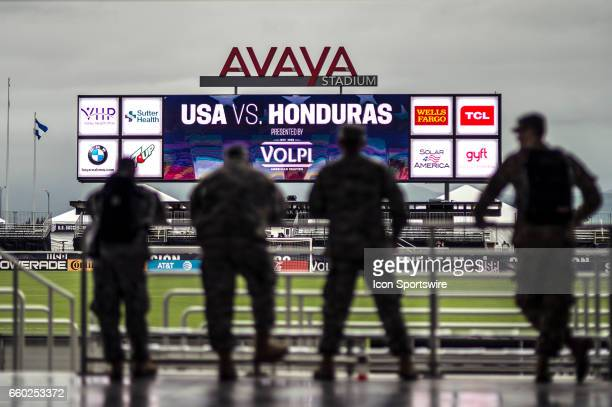 A general view of a large jumbotron at the Avaya Stadium as four members of the armed forces look on during their FIFA 2018 World Cup Qualifier...