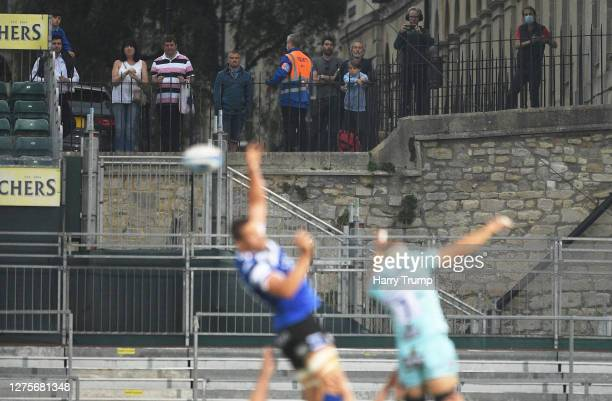 General view of a line out as fans watch on from a nearby road overlooking the ground during the Gallagher Premiership Rugby match between Bath Rugby...