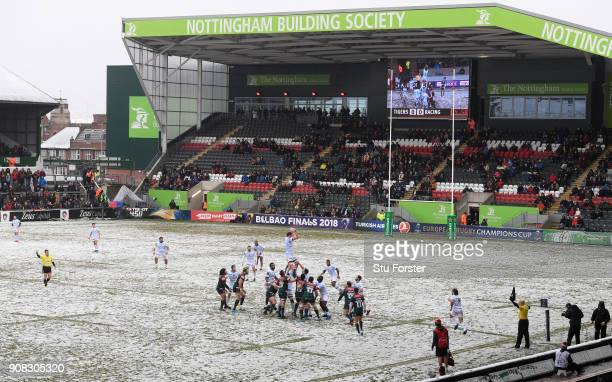 A general view of a lineout on the snow covered pitch during the European Rugby Champions Cup match between Leicester Tigers and Racing 92 at Welford...