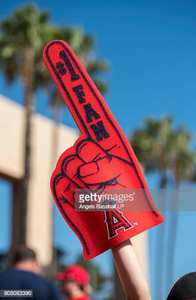 A general view of a Los Angeles Angels of Anaheim fan holding a foam finger outside the stadium before the game against the Texas Rangers at Angel...
