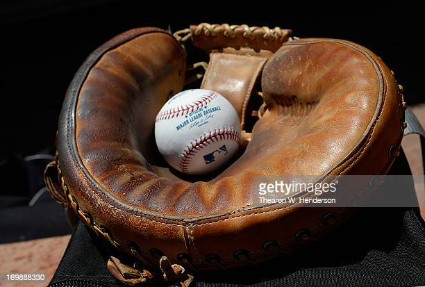 A general view of a Major League Baseball sitting in a catchers glove during a game between the Chicago White Sox and Oakland Athletics at Oco...