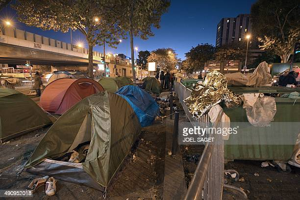 A general view of a makeshift camp setup by mainly Syrian refugees at the Porte de SaintOuen in Paris early on October 2 2015 The French authorities...