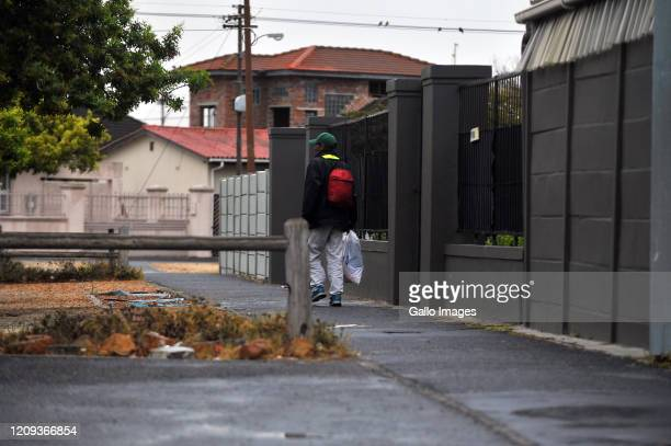 A general view of a man walking the streets cautiously on Day Twelve of National Lockdown on April 07 2020 in Cape Town South Africa According to...