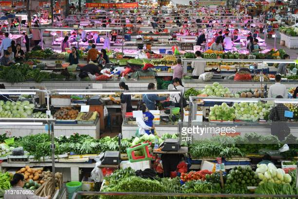 A general view of a market in Nanning in China's southern Guangxi region on April 17 2019 China's economy beat forecasts as it remained steady with...