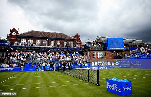 A general view of a minutes silence in memory of the victims of the Orlando shootings ahead of the first round match between Richard Gasquet of...
