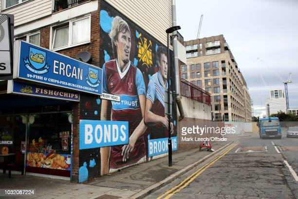 A general view of a mural of Billy Bonds and Trevor Brooking which neighbours the newly constructed flats built in the place of the Chicken Run of...