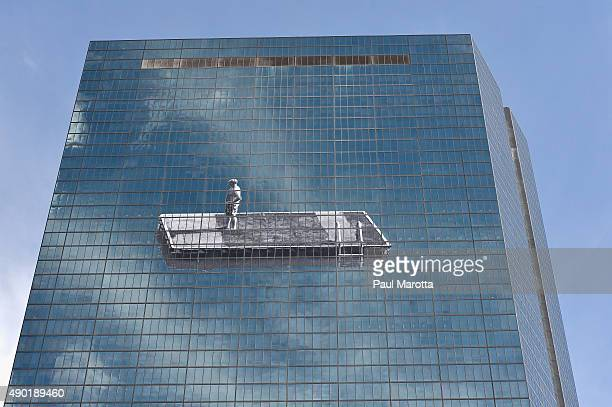A general view of a new mural on the John Hancock building measuring 160 feet wide by 86 feet tall between the 44th and 50 floors by artist JR on...