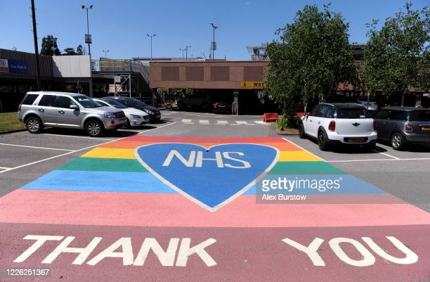 General view of a painted heat and rainbow thanking the NHS which is displayed on the ground in a car park outside Frimley Park Hospital on May 21,...