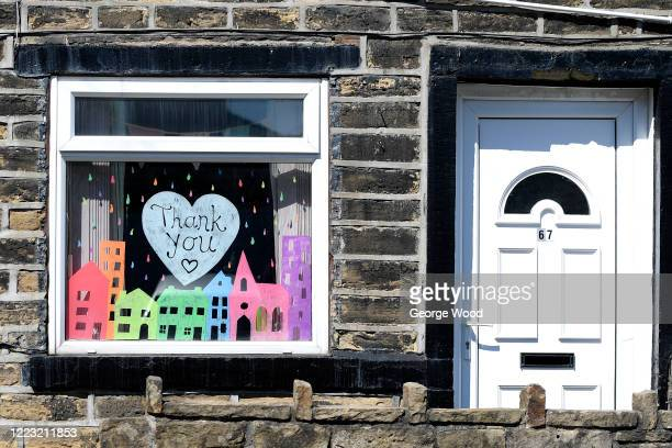 General view of a painting in a house window saying thank you to the NHS and Key Workers on May 06, 2020 in Bradford, England. The UK is continuing...