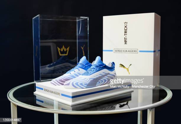 General view of a pair of exclusive Puma football boots presented to Sergio Aguero of Manchester City in recognition of breaking the record for the...