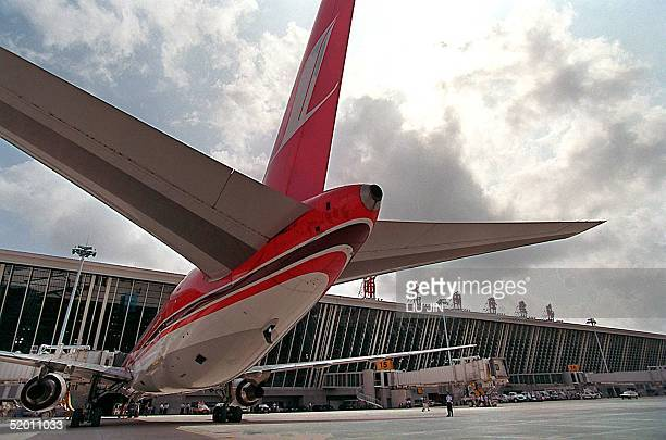 A general view of a parked Shanghai Airlines airplane at a terminal during the opening of Shanghai's new Pudong International Airport 16 September...