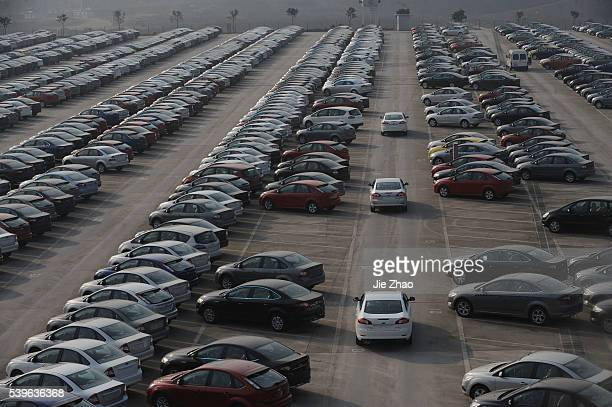 A general view of a parking lot of Changan Ford Mazda Automobile Co Ltd Ford Motor's joint venture in China in Chongqing Municipality January 8 2010...