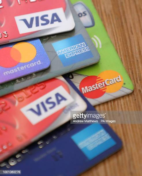 General view of a pile of credit and debit cards including Mastercard American Express and Visa