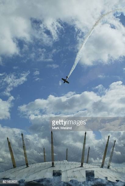 A general view of a plane flying above the O2 Arena in Greenwich during the Red Bull Air Race on August 2 2008 in London The race takes place in 9...