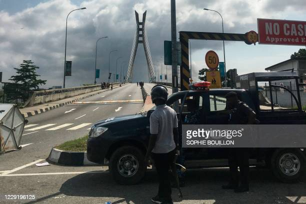 General view of a Police blockade at the Lekki-Ikoyi toll gate in Lagos on October 21 where about twenty people, blocked by curfew, have been facing...