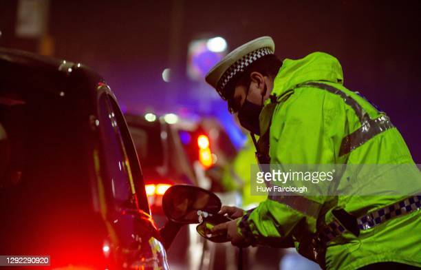 General view of a Police Officer conducting vehicle checks with regards to compliance for drink driving, vehicle condition and Driver Covid...
