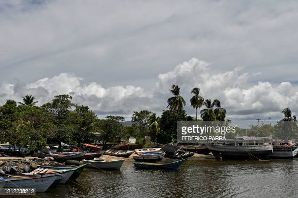 General view of a port of the town of Guiria, Sucre State, Venezuela, on March 13, 2020. - Criminal groups that take victims of human trafficking in...