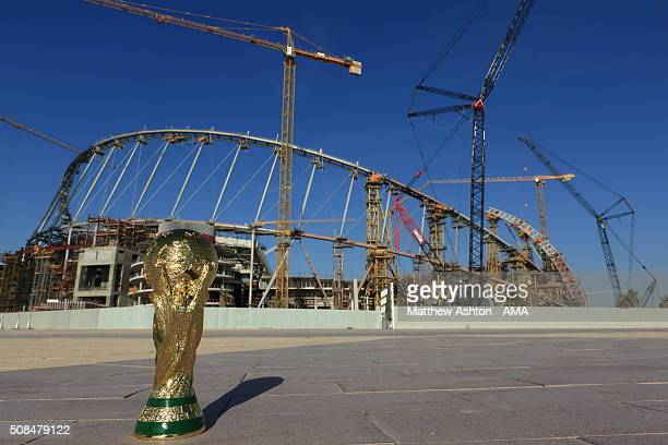 A general view of a replica of the FIFA World Cup trophy in front of cranes and building works during the construction and refurbishment of the...