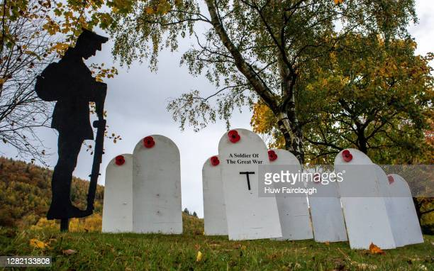 General view of a replica war cemetery with a lone soldier placed in position ready for remembrance day on October 25, 2020 in Abercarn, Wales,...