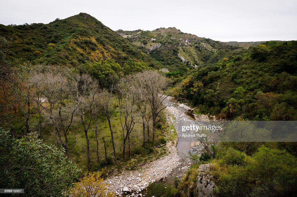 General view of a river surrounded by mountains : Stock Photo