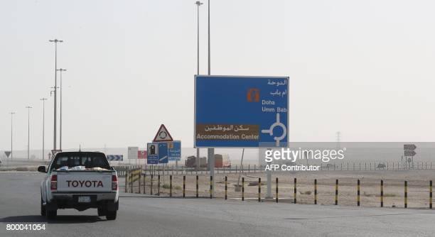 A general view of a road near the Qatari side of the Abu Samrah border crossing with Saudi Arabia on June 23 2017 On June 5 Saudi Arabia and its...