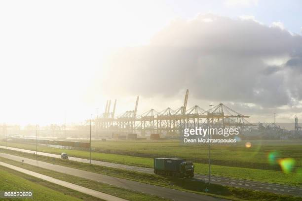 A general view of a road with a truck and car infront of the shipping containers and cranes which move them at the Port of Rotterdam on October 27...