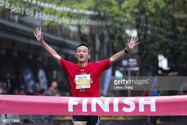 General view of a runner preparing to cross the finish line during the Rock 'n' Roll Marathon Chengdu 2017 at Dujiangyan scenic area on October 28...