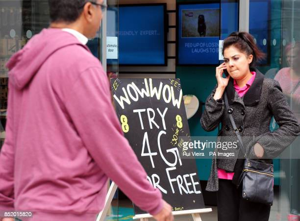 General view of a sandwich board promoting 4G network service outside an EE phone shop Birmingham