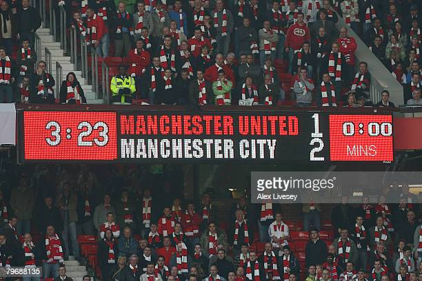 General view of a scoreboard showing the final score during the Barclays Premier League match between Manchester United and Manchester City at Old...
