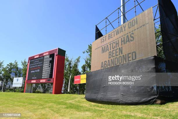 General view of a screen announcing that the first one-day international cricket match between South Africa and England has been abandoned at Boland...