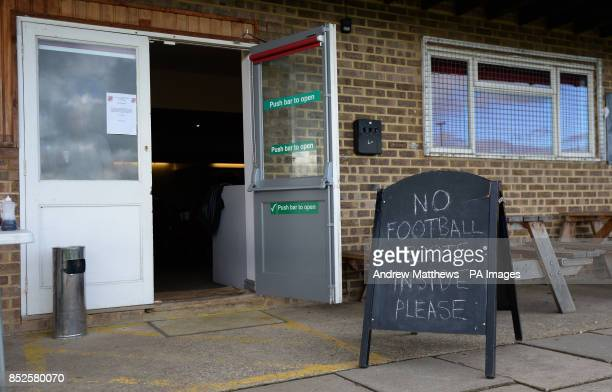 General view of a sign asking for No Football Boots inside the clubhouse at St James Park, home to Brackley Town