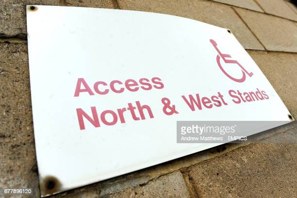 General view of a sign at Sixfields giving directions to Disabled Access to the stands