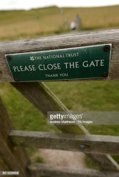 General view of a sign by The National Trust asking members of the public to Please Close The Gate, on Uffington White Horse Hill, Oxfordshire