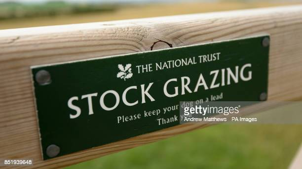 General view of a sign for Stock Grazing by The National Trust on Uffington White Horse Hill, Oxfordshire