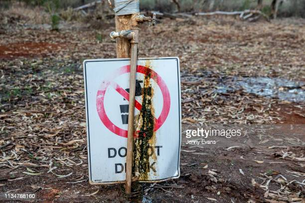 General view of a sign instructing people not to drink the tap water in the Victory Park caravan park on March 04, 2019 in Wilcannia, Australia. The...