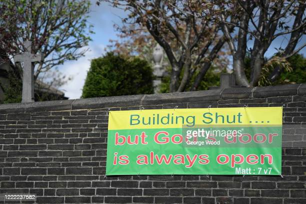 A general view of a sign on the side of a Church wall reminding the public of its clusure on May 01 2020 in Bradford England British Prime Minister...
