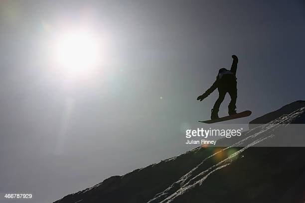 General view of a Slopestyle Snowboarder in action at Rosa Khutor Extreme Park prior to the Sochi 2014 Winter Olympics at the Mountain Cluster on...
