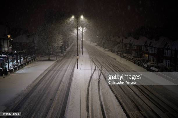 General view of a snow covered road on January 20, 2021 in Didsbury, Lancashire, United Kingdom. Danger to life flood warnings are given along the...