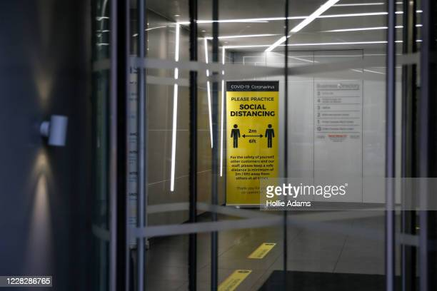 General view of a social distancing notice on display in an empty office lobby on August 31, 2020 in the City of London, England. With offices still...