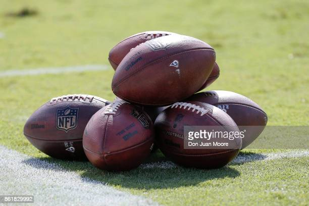 A general view of a stack of Official Wilson NFL DUKE Footballs with the logos of the Los Angeles Rams on it before the game against the Jacksonville...
