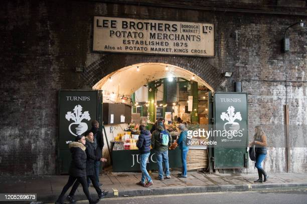 A general view of a stall vendor selling fresh juice in a railway arch at Borough food market on February 4 2020 in London Engalnd The Low Line is a...