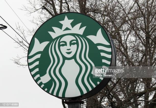 General view of a Starbucks sign as photographed on March 20, 2020 in Westbury, New York.