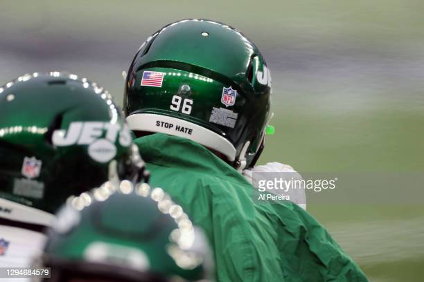 """General view of a """"Stop Hate"""" slogan on the back of Henry Anderson of the New York Jets's helmet in the game against the New England Patriots at..."""