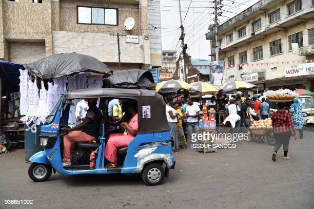 A general view of a street on March 27 2018 in Freetown Sierra Leone's electoral body announced on the eve of a presidential runoff on March 26 that...