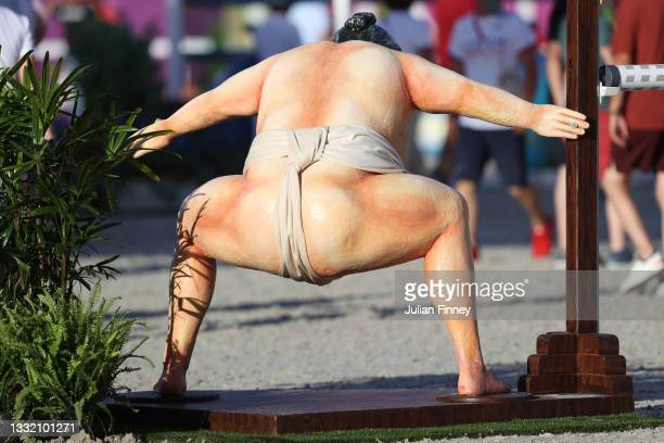 General view of a Sumo wrestler jump is seen during the Jumping Individual Qualifier on day eleven of the Tokyo 2020 Olympic Games at Equestrian Park...