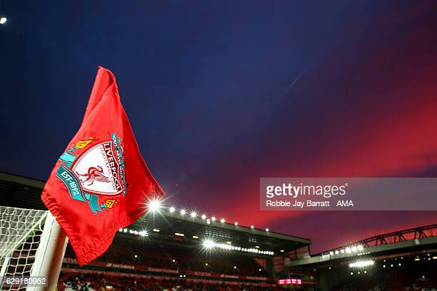 A general view of a sunset over Anfield the home stadium of Liverpool with the badge on a corner flag prior to the Premier League match between...