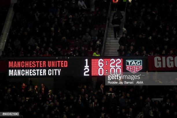 General view of a TAG Heuer scoreboard reads 12 at Old Trafford home stadium of Manchester United during the Premier League match between Manchester...