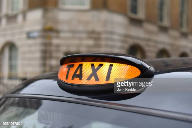 General view of a taxi roof light on top of a London black cab on April 29, 2018 in London, England.