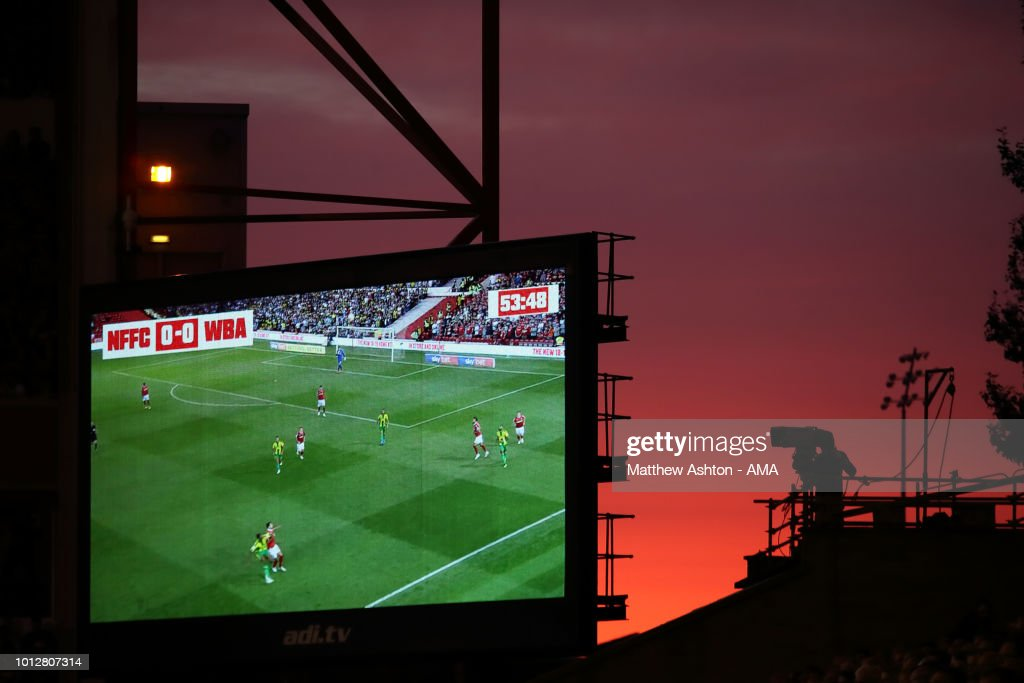 A general view of a Television Broadcast Camera filming the match next to a LED Screen against a sunset during the Sky Bet Championship match between Nottingham Forest v West Bromwich Albion at City Ground on August 7, 2018 in Nottingham, England.