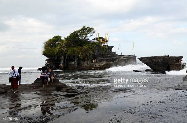 General view of a temple in Tanah Lot where Balinese people celebrate the holiday of Kuningan in Tabanan on Indonesia's tourist island of Bali on May...